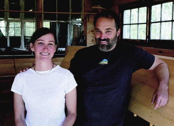 Allison Warner and Rob Davidson at their shop in Lake Clear. PHOTO BY MIKE LYNCH