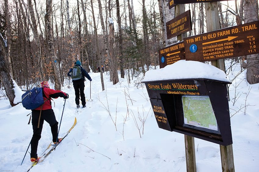 Skiers head up one of the old ski trails reopened by Steve Ovitt. PHOTO BY NANCIE BATTAGLIA