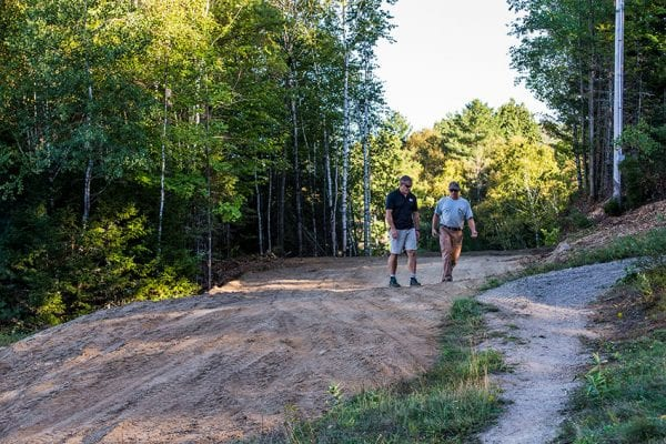 Steve Tomb, left, and Steve Ovitt inspect a trail under construction at the Ski Bowl. Photo by Nancie Battaglia
