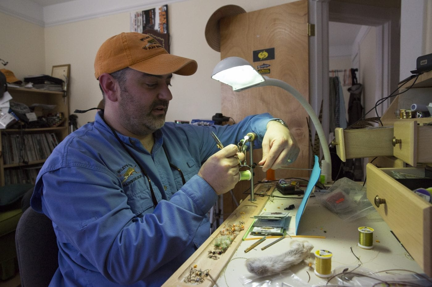 Wiley's Flies owner Vince Wilcox ties a fly in his Ray Brook shop