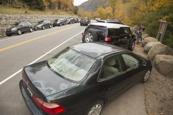 Cascade Mountain parking on Sunday, October 15, 2016, during Columbus Day weekend. When parking lots fill up on state Route 73, drivers often park their motor vehicles along the road, sometimes creating dangerous situations for passing vehicles and hikers.