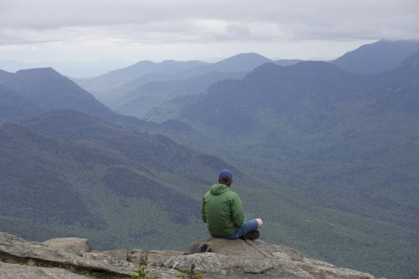 A hiker takes in the views from Giant Mountain this past spring, finding solitude on an otherwise busy weekend.