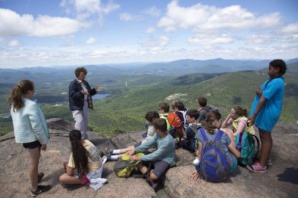 A summit steward talks to hikers on Cascade Mountain.