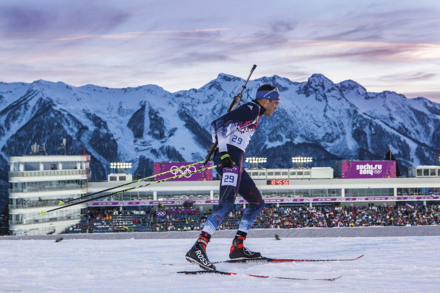 Biathlete Tim Burke skis at the 2014 Sochi Winter Olympics.