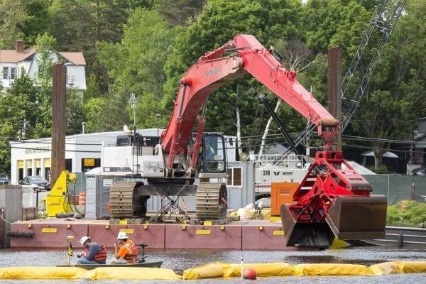 Crews work to clean up Lake Flower on June 7.