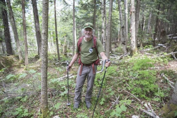Ron Konowitz, of the Adirondack Powder Skier's Association, stands in the woods on Wright Peak in late May.