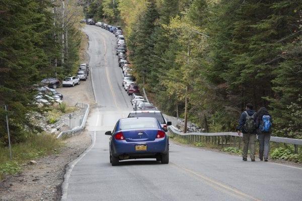Cars line Adirondack Loj Road on a busy fall weekend.