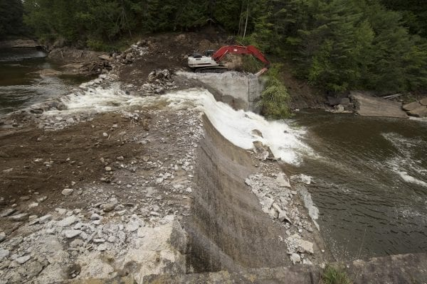 Crews work to remove the Rome Dam on the West Branch of the Ausable River on August 28, 2018. The dam is located upstream of Ausable Forks. Photo by Mike Lynch