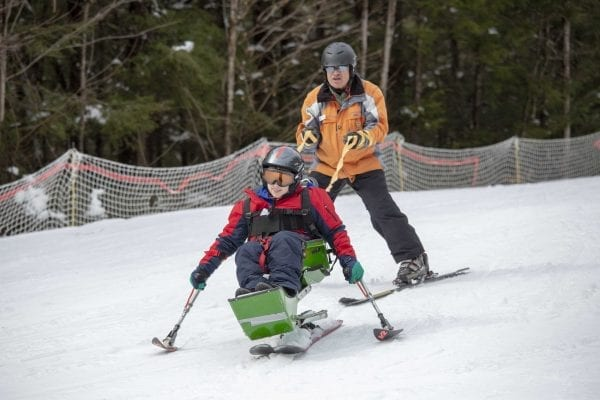 Adaptive skier Eric Weiler pulls instructor Allan Miller downhill at Double H Ranch. Photo by Mike Lynch