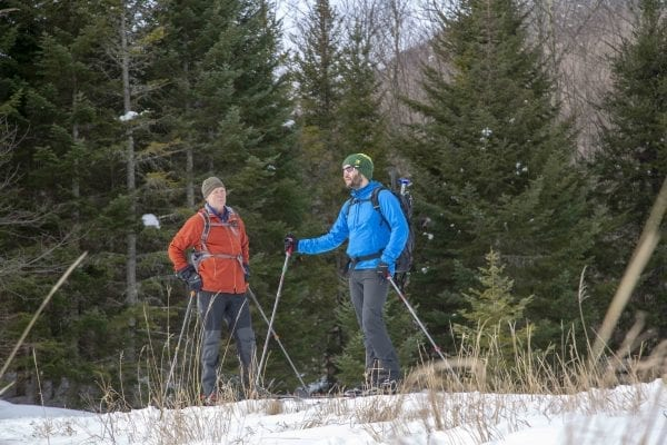 BETA executive director Josh Wilson talks with former Explorer editor Phil Brown in March 2018 while skiing Old Mountain Road. Photo by Mike Lynch