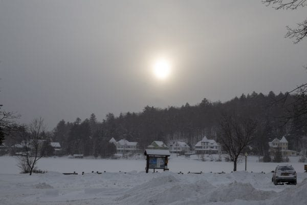 The sun drops in the sky over Lake Flower in Saranac Lake. Photo by Mike Lynch