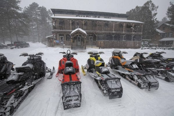 Snowmobilers provide income for restaurants in small communities throughout the Adirondack Park. Charlie's Inn in Lake Clear is a popular stop for riders. Photo by Mike Lynch