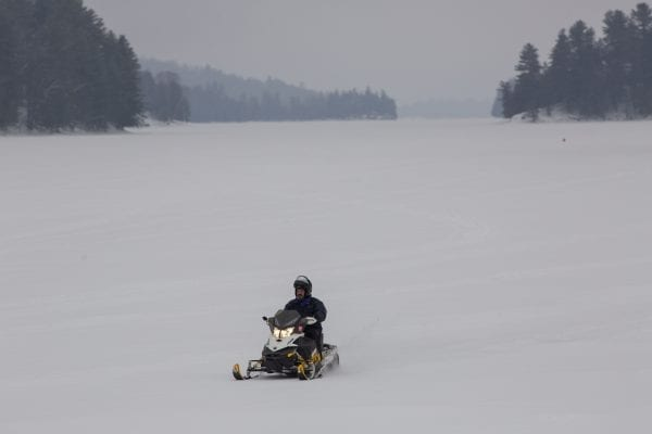 A lone snowmobiler on Long Lake in Hamilton County. Photo by Mike Lynch