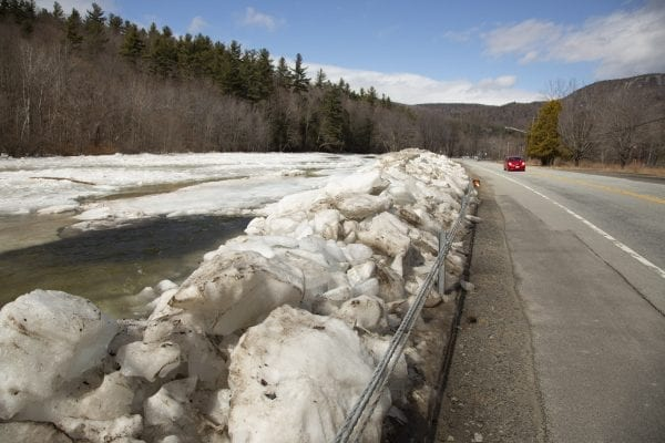 River ice piled along state Route 9N in Upper Jay. It was removed from the river by crews earlier this winter. Photo by Mike Lynch