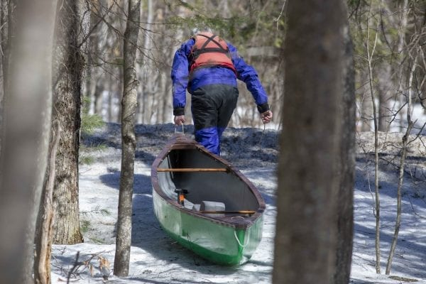 Marty Plante runs the Cedar River in early April, when conditions were still winterlike. Photo by Mike Lynch