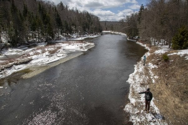 A man fishes in open water on the West Branch of the Ausable River April 1. Photo by Mike Lynch