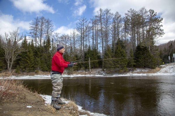 A fly fisherman braves the cold on April 1, the opening day of the trout fishing season. Photo by Mike Lynch