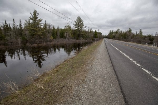 The Raquette River approaches Route 3 near Tupper Lake on April 25. Photo by Mike Lynch