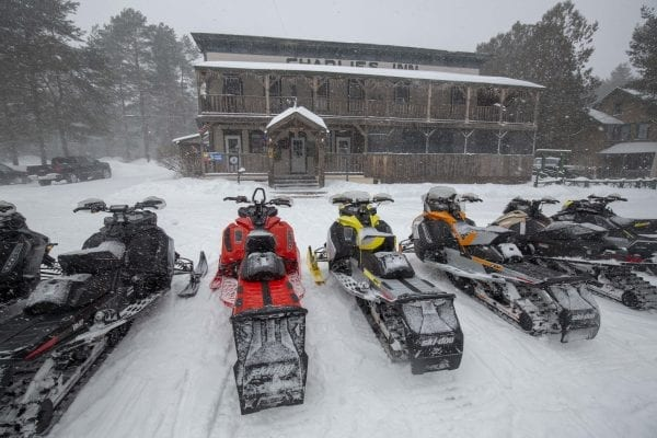 Charlie's Inn is a popular spot for snowmobilers in Lake Clear along the railroad tracks. Photo by Mike Lynch
