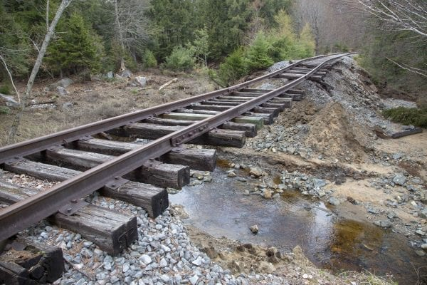 A large section of this railroad bed near Hoel Pond washed out by a stream. Parts of the rail route are in disrepair. Photo by Mike Lynch