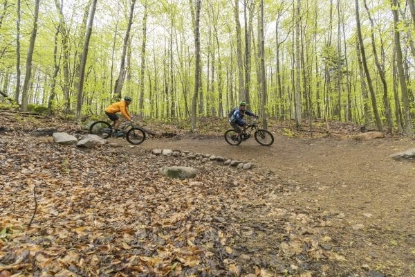 Mountain bikers take on McCauley Mountain in Old Forge in May. Photo by Mike Lynch