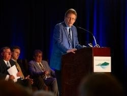 John E. Kelly, III, the executive vice president of IBM, speaks at the annual meeting of the Fund for Lake George July 6.