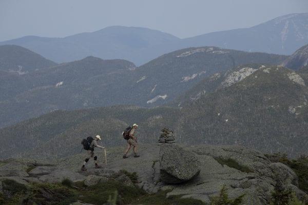 Summit stewards walk along a ridge on Mount Marcy in July. Photo by Mike Lynch