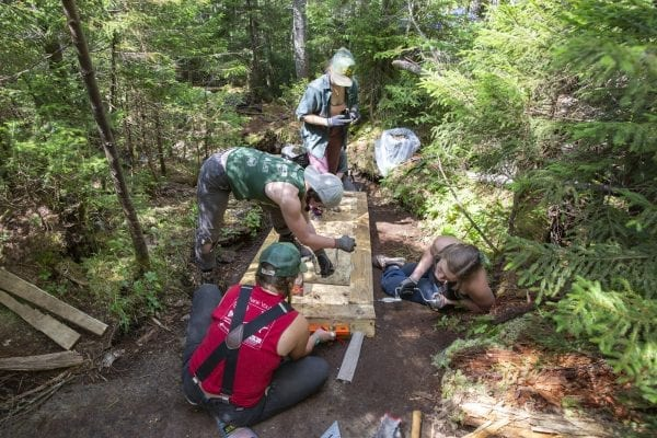 The professional trail crew works on a staircase on the trail up Mount Colden. Photo by Mike Lynch