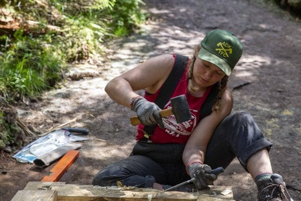Professional trail crew member Anastasia Rodak works on Mount Colden. Photo by Mike Lynch