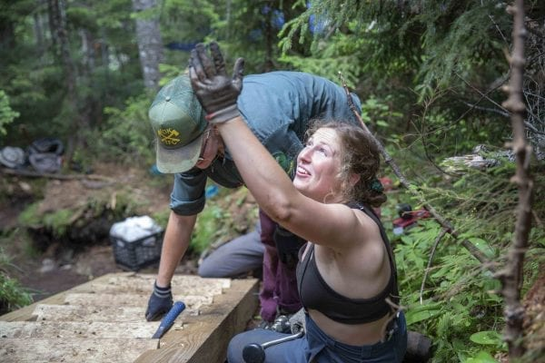 ADK professional trail crew member Caitlin Kelly works on a staircase on Mount Colden. Photo by Mike Lynch