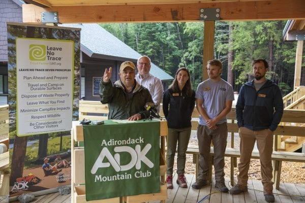 Adirondack Mountain Club executive director Neil Woodworth talks at the High Peaks Information Center during the kickoff of the Leave No Trace Hot Spot week in August. LNT principles were the topic of activities during the Hot Spot period. Photo by Mike Lynch