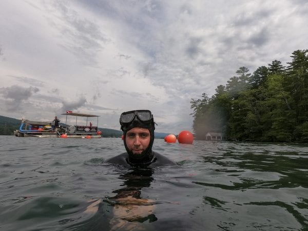 A professional diver from AE Commercial Diving Services treads water near Clay Island on Lake George in July. He's part of a team removing milfoil from the lake. Photo by Mike Lynch