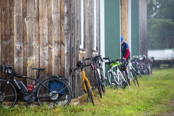 Cyclists lean their bikes against a barn at Reber Rock Farm in August. Photo by Mike Lynch