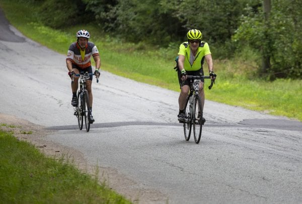 Cycle Adirondacks participants ride through farmlands in the Champlain Valley. Photo by Mike Lynch