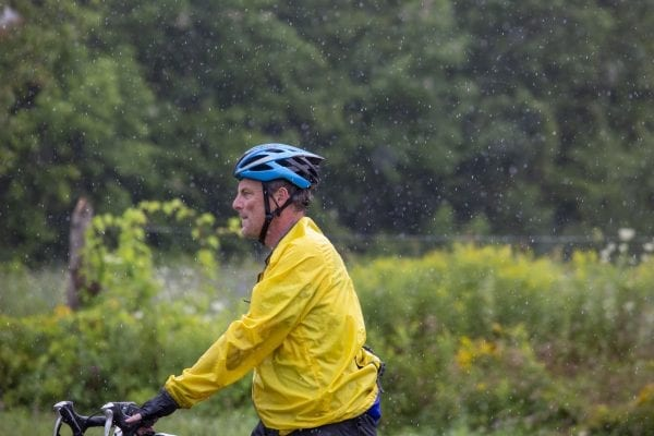 A Cycle Adirondacks participant enters Reber Rock Farm for a scheduled lunch break. Photo by Mike Lynch