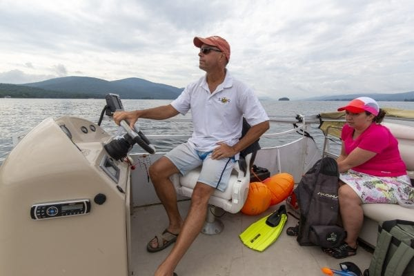 David Wick, executive director of the Lake George Park Commission, drives a crew of swimmers looking for milfoil on Lake George. Photo by Mike Lynch