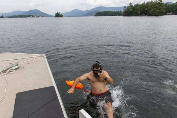 Joe Thouin, of the Lake George Park Commission, jumps into Lake George during a milfoil survey. Photo by Mike Lynch