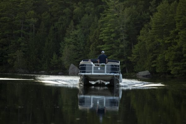 A motor boat heading in the direction of the Second Pond state boat launch. Photo by Mike Lynch