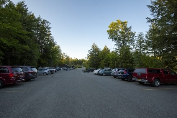 The boat launch parking lot at Second Pond, which provides access to Lower Saranac Lake. Photo by Mike Lynch