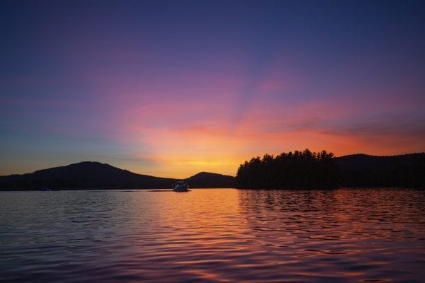 A colorful sunset on Lower Saranac Lake. Photo by Mike Lynch