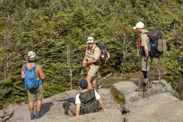 Summit steward Mary Lamb talks to hikers on Mount Marcy about alpine vegetation. Photo by Mike Lynch