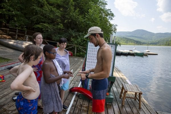 A camper enjoys a game with a counselor after swimming at Camp Lincoln in the northeastern Adirondacks. Photo by Mike Lynch