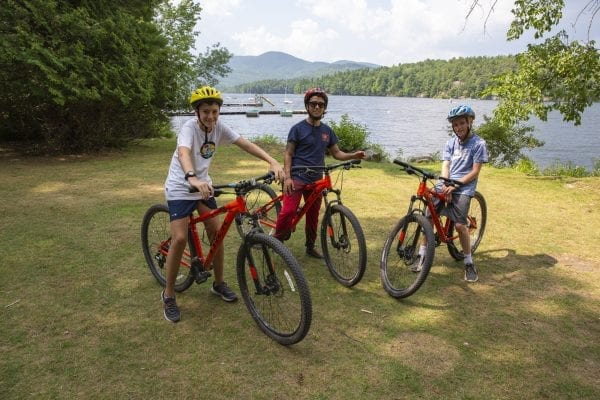 Children ride bikes at Camp Whippoorwill in the northeastern Adirondacks. Photo by Mike Lynch
