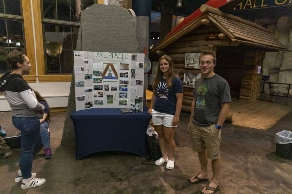 Students set up displays in the lobby at The Wild Center for the event. Photo by Mike Lynch
