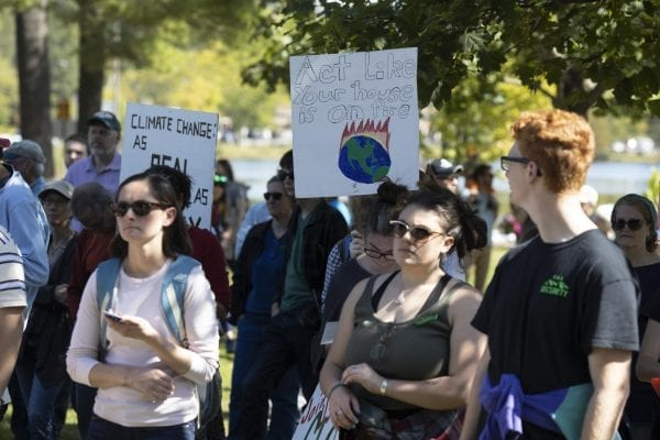 Many high school students from the Tri-Lakes left school to participate in Friday's climate strike held at Riverside Park in Saranac Lake. Overall several hundred people attended the demonstration. Photo by Mike Lynch
