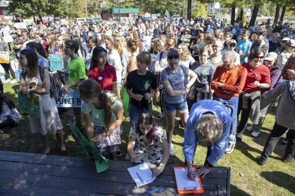 Many high school students from the Tri-Lakes left school to participate in climate strike held at Riverside Park in Saranac Lake on September 20. Overall several hundred people attended the demonstration. Photo by Mike Lynch