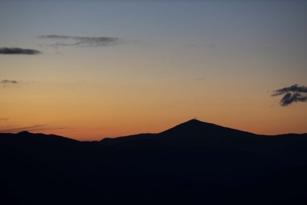 Whiteface Mountain surrounded by the orange glow of sunset. Photo by Mike Lynch