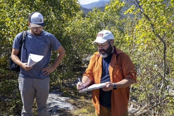 SUNY Plattsburgh Professor Mark Lesser and his students visited the 1999 Noonmark Fire site in September. Photo by Mike Lynch
