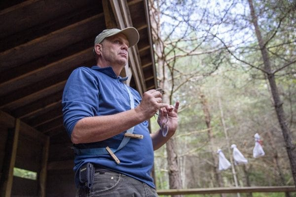 Eric Lind, director of community services and restoration for the New York state chapter of the Audobon Society, led a bird banding demonstration at The Wild Center in mid-August. Photo by Mike Lynch