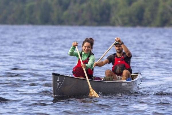 Olivier Van Herck and Zoë Agasi paddle on Franklin Falls Pond in August. The European couple are on a four-year human-powered journey that has included biking through portions of Europe and South, Central and North America, sailing across the Atlantic Ocean, hiking on the Appalachian Trail, and paddling the Northern Forest Canoe Trail.  Photo by Mike Lynch